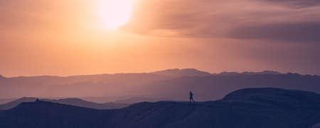 Athlete runs through the desert highlands. Trailing ranning. National Park Altyn-Emel. Kazakhstan