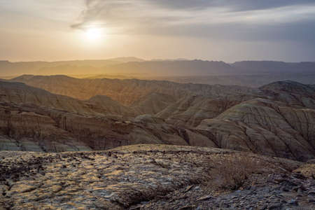 Sunset in the desert area in the mountains. Fancy Sand Canyons. National Park Altyn-Emel. Kazakhstan