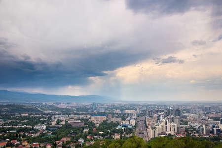 Almaty, Kazakhstan - JUNE 26, 2017: City summer landscape. Panorama of the summer city. Rainy weather Editorial