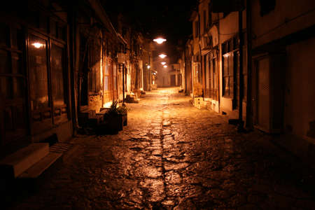 gravel roads: Old street at night
