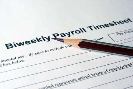 salarios: N�mina de hoja de tiempo Foto de archivo