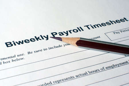 statements: Payroll timesheet Stock Photo