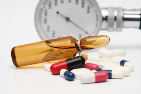 Pills and medicine vial photo
