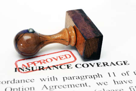 insurance concepts: Insurance coverage and wooden stamp Stock Photo