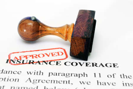 Insurance coverage and wooden stamp photo