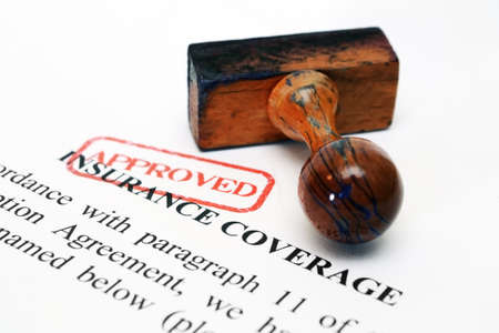 policies: Insurance coverage and wooden stamp Stock Photo
