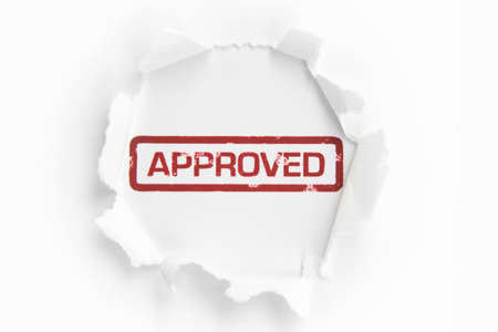 Approved paper hole Stock Photo - 14650096