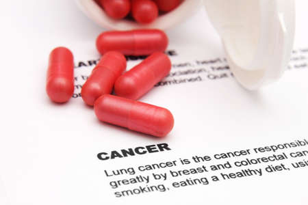 pancreatic cancer: Pills on cancer text Stock Photo