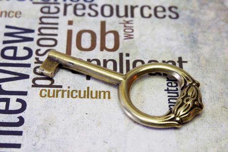 Golden key on job text Stock Photo - 18122322