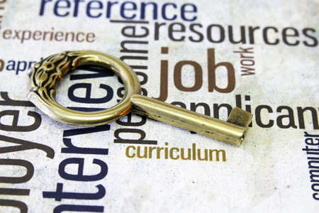 Golden key on job text Stock Photo - 18122333