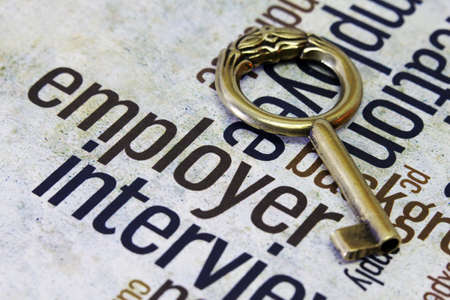 Old key on employer text Stock Photo - 18122334