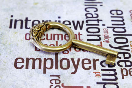Old key on employer text Stock Photo - 18122344