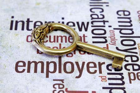 employer: Old key on employer text Stock Photo