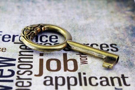Golden key on job text Stock Photo - 18282096
