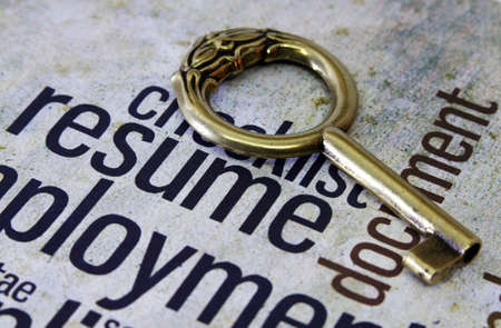 Golden key on resume text Stock Photo - 18282097