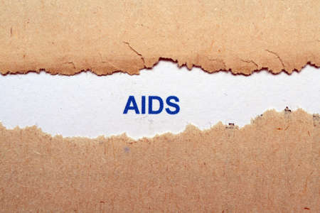 Aids text on torn paper photo