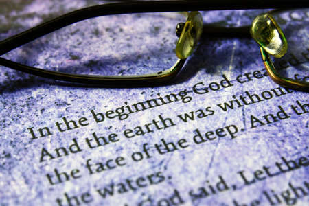 Reading  glasses on bible text photo