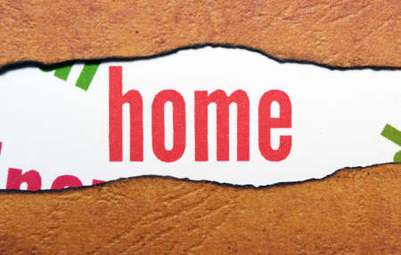 plied: Home text on torn paper Stock Photo