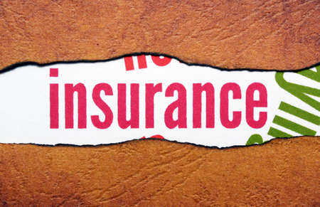 Insurance text on torn paper photo
