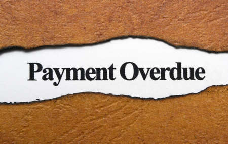 overdue: Payment overdue text on torn paper