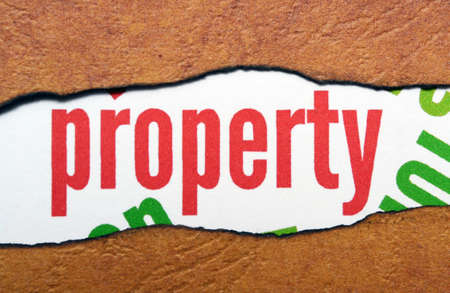 goffer: Property text on torn paper Stock Photo