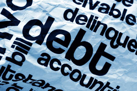 debt collection: Debt text on paper