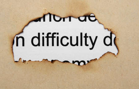 Difficulty text on paper hole photo