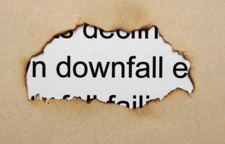 Downfall text on paper hole photo