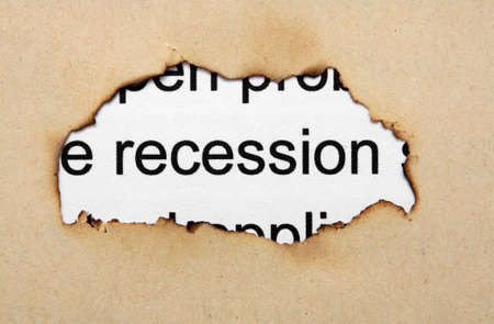 burning money: Recession text on paper hole