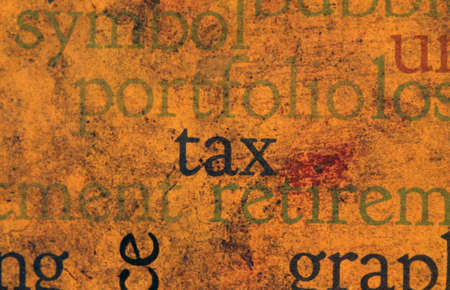 Tax text on grunge background photo
