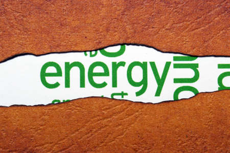 Energy text on torn paper photo