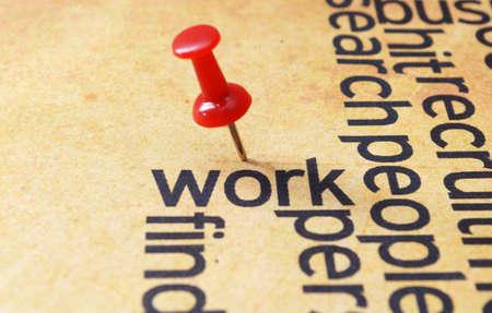 pinning: Push pin on work text Stock Photo