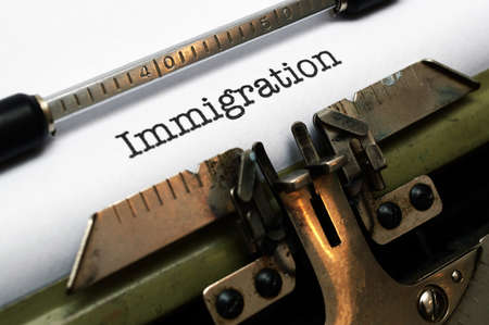 Immigration text on typewriter photo