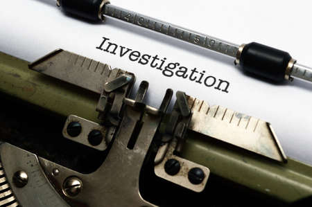 Investigation text on typewriter photo