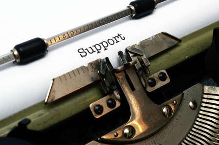 Support text on typewriter photo