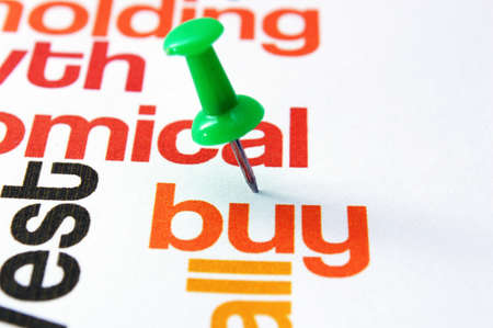 Push pin on buy text Stock Photo - 21633984