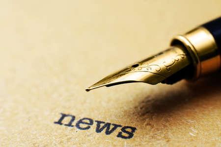 release: Fountain pen on news text Stock Photo