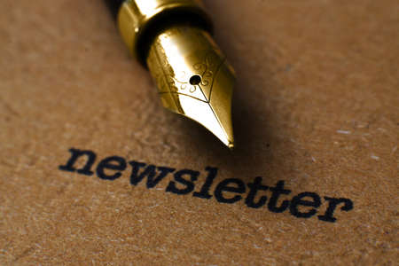 Fountain pen on newsletter  text photo
