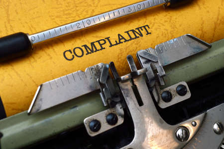 discontent: Complaint text on typewriter Stock Photo
