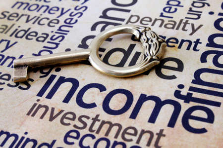 Golden key on income text Stock Photo