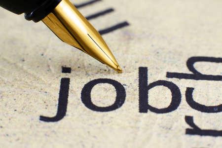 contractual: Fountain pen on job text Stock Photo