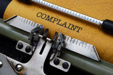 allegation: Complaint  text on typewriter
