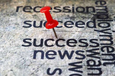 Push pin on success news Stock Photo