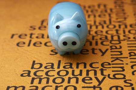 Piggy bank on balance account money photo