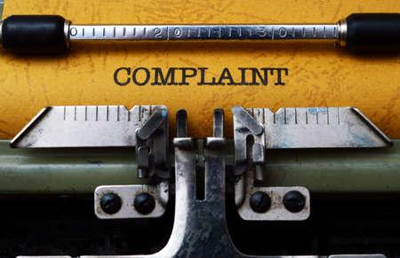 allegation: Complaint text on typewriter Stock Photo