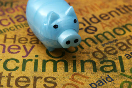 law business: Piggy bank and criminal concept Stock Photo