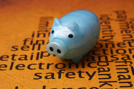 Electronic safety and piggy bank concept photo
