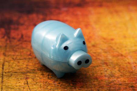 Piggy bank on grunge background photo