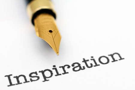 Push pin on inspiration text Stock Photo - 24077670