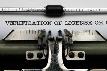 Verification of license on typewriter photo